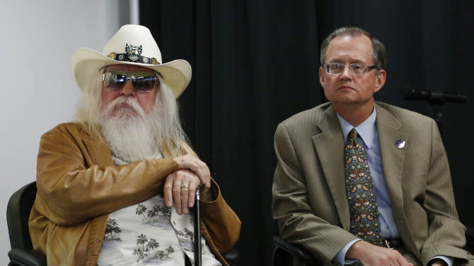 Leon Russell, left, leans on his cane as he sits with Bob Blackburn, executive director of the Oklahoma Historical Society, in Tulsa, Okla., Tuesday, Jan. 29, 2013. The Oklahoma Historical Society has acquired a large collection of works by the legendary musician and native Oklahoman that are intended for display in a planned pop culture museum in Tulsa. (AP Photo/Sue Ogrocki)