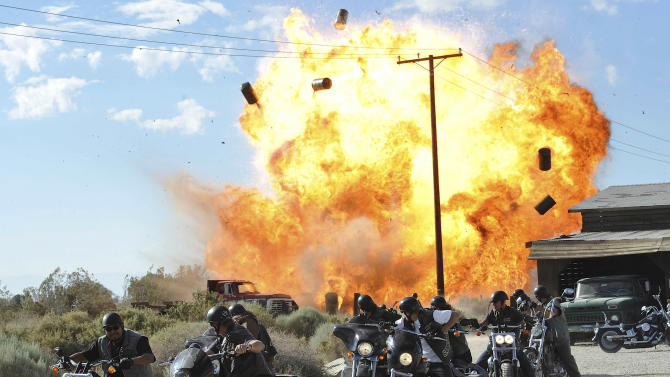"""FILE - In this file image released by FX, a scene is shown from the FX original series, """"Sons of Anarchy."""" Television executives who spoke to the media recently about the tragic shootings in Newtown, Conn., and Aurora, Colo., say the events bothered them, but none offered concrete examples of how it is changing what they put on the air, or if that is necessary. FX President John Landgraf said he was in favor of further study about any correlation between entertainment and real violence. Landgraf pointed out that the zombie series """"Walking Dead"""" and brutally violent """"Sons of Anarchy"""" are both very popular in England and that country has far fewer gun murders than the United States. (AP Photo/FX, Prashant Gupta, File)"""