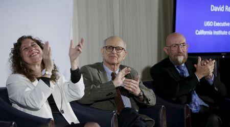 Doctors Gabriela Gonzalez, Rainer Weiss and Kip Thorne applaud the announcement of the detection of gravitational waves, ripples in space and time hypothesized by physicist Albert Einstein a century ago, in Washington