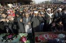 Mourners pray during a mass funeral in Fallujah, 40 miles (65 kilometers) west of Baghdad, Iraq, Saturday, Jan. 26, 2013. Hundreds of Iraqi protesters have gathered in Fallujah for the funeral of six protesters killed during shooting by army troops a day earlier. (AP Photo/ Khalid Mohammed)