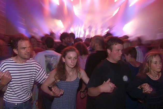 This Aug.2002 photo shows people dancing during a Fest-Noz in Lorient, Brittany. Fest-Noz is a festive gathering based on the collective practice of traditional Breton dances, accompanied by singing or instrumental music. The Breton cultural movement has preserved this expression of a living and constantly renewed practice of inherited dance repertoires with several hundred variations, and thousands of tunes. The UNESCO inscribed Fest-Noz on the Representative List of the Intangible Cultural Heritage of Humanity. (AP Photo/David Vincent)