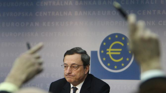 Mario Draghi,  President of the European Central Bank speaks during a press conference while journalists lift their hands to ask a question in Frankfurt, Germany, Thursday, Dec.8, 2011. The ECB announced to lower their key interest rate by 25 basis points to one percent. (AP Photo/Michael Probst)