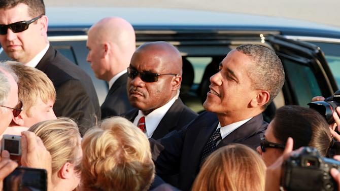 President Barack Obama greets well-wishers as he arrives at JFK International Airport in New York, Wednesday, Aug. 22, 2012, on his way to a visit in New York City where he attends several fundraiser events  (AP Photo/David Karp)