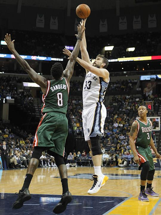 Memphis Grizzlies center Marc Gasol (33), of Spain, shoots against Milwaukee Bucks center Larry Sanders (8) and forward Caron Butler (3) in the second half of an NBA basketball game on Saturday, Feb.