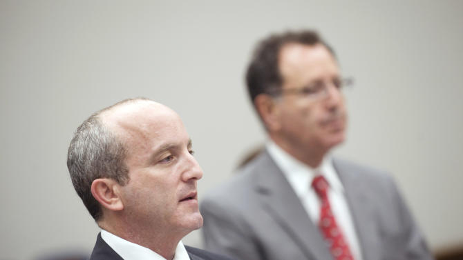 Orange County Deputy District Attorney Andrew Katz, left, addresses the court as defense attorney Ron Cordova listens during the arraignment of Rainer Reinscheid at the Harbor Justice Center in Newport Beach, Calif. on Wednesday, Aug. 8, 2012.  An amended complaint issued Wednesday charged Reinscheid with eight counts of arson and one count of attempted arson for a series of small fires at the park where his son hanged himself in March, the high school and the home of a school administrator who had disciplined his son. (AP Photo/The Orange County Register, Paul Bersebach, Pool)