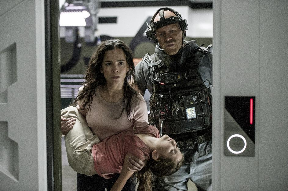 "This film publicity image released by Tristar, Columbia Pictures-Sony shows Alice Braga, left, Emma Tremblay and Josh Blacker, right, in a scene from ""Elysium."" (AP Photo/Tristar, Columbia Pictures - Sony, Kimberley French)"