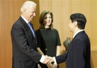 U.S. Vice President Joe Biden (L), accompanied by U.S. Ambassador to Japan Caroline Kennedy, is greeted by Japan's Crown Prince Naruhito upon his arrival at the Togu Palace in Tokyo November 3, 2013. REUTERS/Junji Kurokawa/Pool