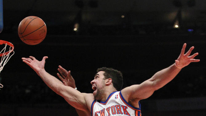 New York Knicks' Landry Fields drives past Los Angeles Clippers' Ike Diogu during the first half of an NBA basketball game Wednesday, Feb. 9, 2011, in New York.  (AP Photo/Frank Franklin II)