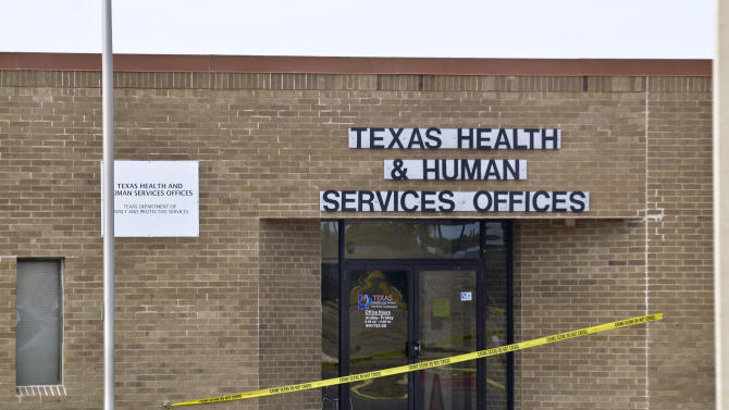 Crime Scene tape is posted at the main entrance to the Texas Health and Human Services Offices in Laredo, Texas, Tuesday, Dec., 6, 2011.  A Texas woman who for months was unable to qualify for food stamps pulled a gun in a state welfare office and staged a seven-hour standoff with police that ended with her shooting her two children before killing herself, officials said Tuesday.  Authorities identified the mother as Rachelle Grimmer, 38, and children Ramie and Timothy. Laredo police investigator Joe Baeza said Grimmer had recently moved to the border city from Zanesville, Ohio, about 30 miles east of Columbus.  (AP Photo/The Laredo Morning Times, Cuate Santos)