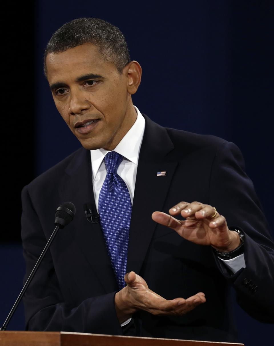 President Barack Obama answers a question during the first presidential debate at the University of Denver, Wednesday, Oct. 3, 2012, in Denver. (AP Photo/Charlie Neibergall)