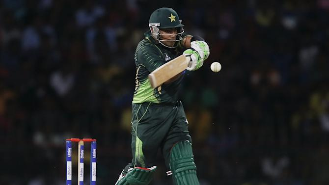 Pakistan's Akmal hits a boundary during their first Twenty 20 cricket match against Sri Lanka in Colombo