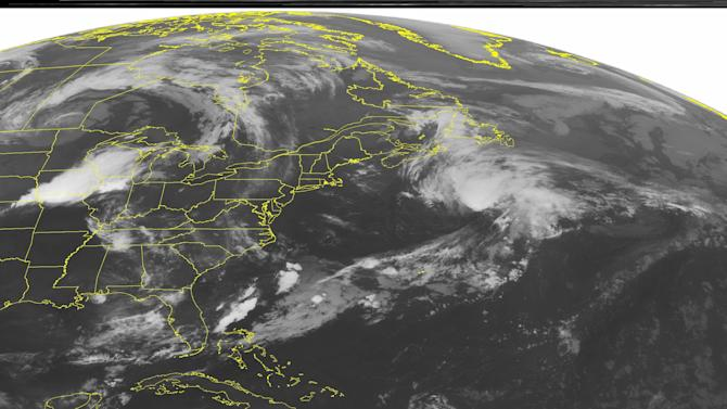 This NOAA satellite image taken Wednesday, July 29, 2015 at 12:45 a.m. EDT, shows a large area of thunderstorms moving through the Middle Mississippi Valley and the Midwest just ahead of a surface cold front. Lingering rain showers are also covering parts of Florida and the Tennessee Valley. (Weather Underground via AP)