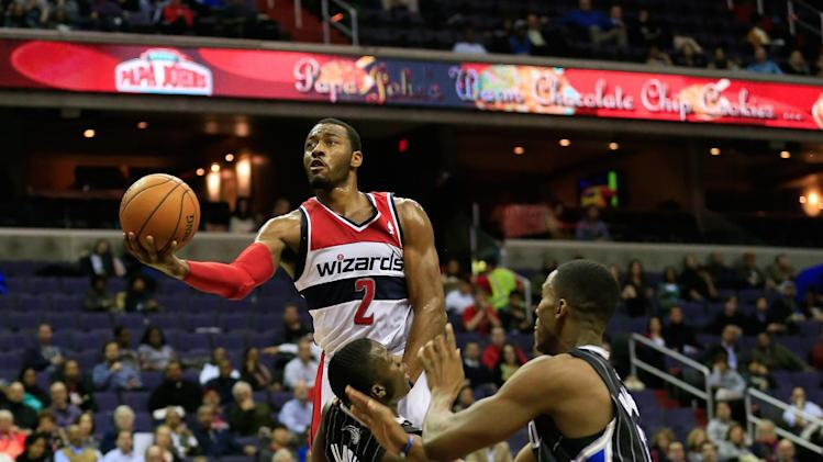 Ariza, Wall lead Wizards past Magic 98-80