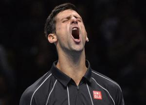 Novak Djokovic reacts after breaking Rafael Nadal's serve at the ATP World Tour Finals in London