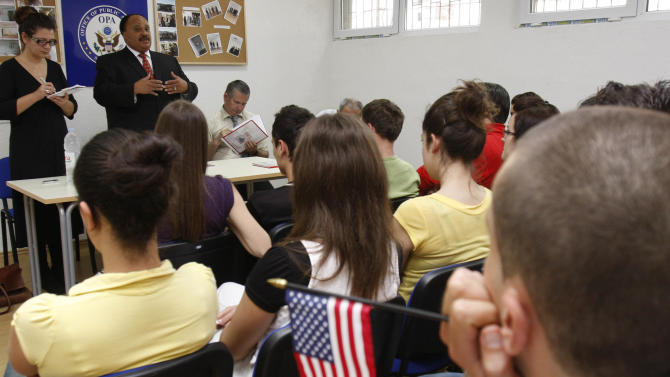"FILE - In this May 15, 2009 file photo, Martin Luther King III, son of Dr. Martin Luther King Jr., addresses students at a high school in the southern Bosnian town of Stolac, 75 kilometers (46 miles) south of the Bosnian capital of Sarajevo. Stolac High School is an example of Bosnia's post-war phenomena ""two schools under one roof"" which hosts students of all nationalities but divides them in two shifts. Management makes sure the students of different ethnic groups never meet each other. International officials warn that this is one of the worst cases of segregation in Europe. (AP Photo/Amel Emric, File)"
