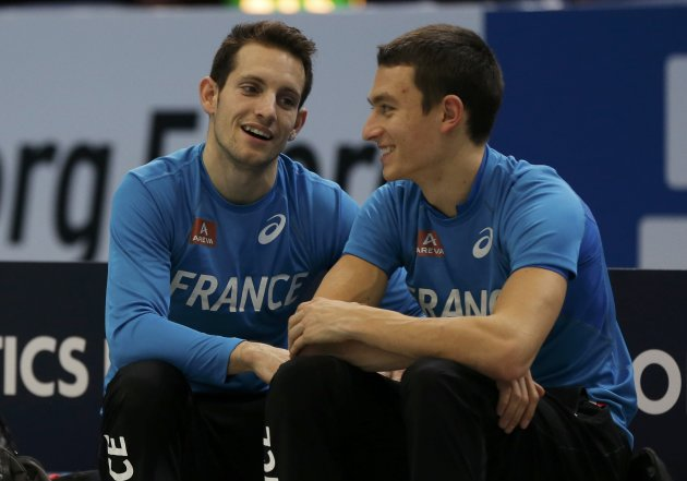 French pole vaulters Lavillenie and Joseph chat during the Pole Vault Men Qualification event at the European Athletics Indoor Championships in Gothenburg