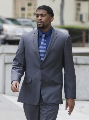Former Auburn basketball player Varez Ward departs the federal courthouse in Montgomery, Ala., Thursday, June 6, 2013, after pleading innocent while being arraigned on charges accusing him of conspiring to fix a game. Ward was arrested on Monday on charges of bribery related to a sports contest and conspiracy for allegedly trying to fix the point spread in Auburn's game against Arkansas on Jan. 25, 2012. Ward came off the bench but crumpled to the floor after playing only 19 seconds with an apparent leg injury. Arkansas won 56-53.(AP Photo/Dave Martin)