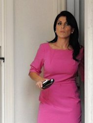 "Jill Kelley, the Florida socialite at the heart of the scandal that brought down CIA chief David Petraeus, leaves her home in Tampa on November 13, 2012. South Korea said Tuesday it was dismissing Kelley from her post as an ""honorary consul"""
