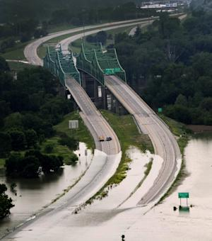 Interstate 680, which connects Omaha, Neb., with Iowa at the Mormon Bridge, is flooded at the Iowa side, Tuesday, June 14, 2011. On Tuesday, the releases at Gavins Point Dam in South Dakota hit the maximum planned amount of 150,000 cubic feet of water per second, which is expected to raise the Missouri River five to seven feet above flood stage in most of Nebraska and Iowa. (AP Photo/Nati Harnik)