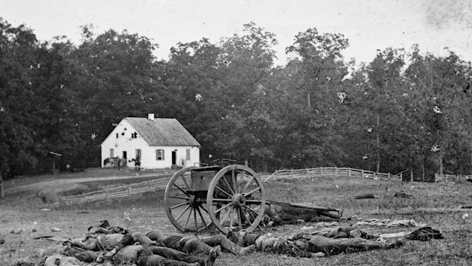 """This 1862 photograph made available by the Library of Congress shows casualties from the Battle of Antietam near the church of the pacifist Dunker sect near Sharpsburg, Md. When dawn broke along Antietam Creek on Sept. 17, 1862, cannon volleys launched a Civil War battle that would leave 23,000 casualties on the single bloodiest day in U.S. history and mark a crucial pivot point in the war. And yet it might never have occurred - if not for what a historian calls a """"freakish"""" twist of fate. Days earlier, a copy of Gen. Robert E. Lee's detailed invasion orders, wrapped around a few cigars, accidentally fell in a farm field and were discovered by Union infantrymen who passed their stunning find up the chain of command, spurring action. (AP Photo/Library of Congress)"""