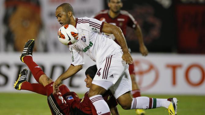 Leandro of Brazil's Fluminense challenges Sanchez of Venezuela's Caracas FC during their Copa Libertadores soccer match in Caracas