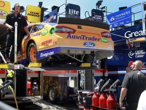 Driver Joey Logano's crew unloads his backup car …