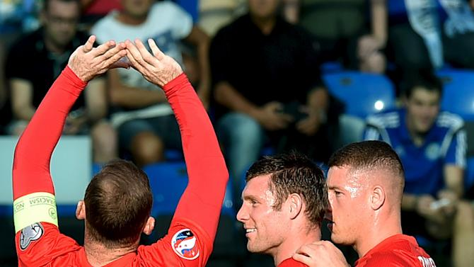 England's Rooney celebrates with team mates Milner and Barkley after scoring a goal during their Euro 2016 qualification match against San Marino at the Olympic stadium in Serravalle