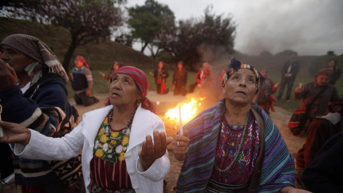 Mayan priests and priestesses gather during a ceremony in Guatemala City