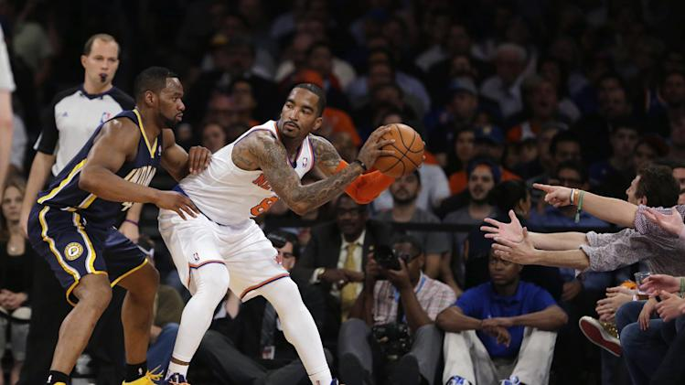 Indiana Pacers' Sam Young, left, defends New York Knicks' J.R. Smith in the first half of Game 5 of an Eastern Conference semifinal in the NBA basketball playoffs, at Madison Square Garden in New York, Thursday, May 16, 2013. (AP Photo/Julio Cortez)