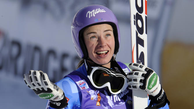 Tina Maze, of Slovenia, celebrates at the finish area after placing second an Alpine Ski World Cup women's downhill, in Cortina D'Ampezzo, Italy, Saturday, Jan.19, 2013. (AP Photo/Giovanni Auletta)