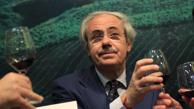 """Sicily region governor Raffaele Lombardo tastes a glass of red wine at the 46th edition of the annual International Wine and Spirits Exhibition """"Vinitaly"""", in Verona, northern Italy, Monday, March 26, 2012. """"The companies show that by defeating the Mafia you can begin to legally produce wines, oil and high-quality agricultural goods in the interest of the workers and the producers,"""" Sicily's governor Raffaele Lombardo told The Associated Press at Vinitaly on Monday.  (AP Photo/Luca Bruno)"""