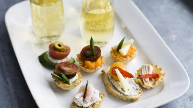 In this Jan. 28, 2013 photo, using our building block approach to Oscar party canapes, diners are able to select from a buffet of ingredients -- from bases and spreads to toppings and garnishes -- to design snacks that suit their preferences as shown on this serving tray in Concord, N.H. (AP Photo/Matthew Mead)