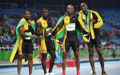 Jamaica's Yohan Blake, Jamaica's Nickel Ashmeade, Jamaica's Asafa Powell and Jamaica's Usain Bolt celebrate after they won the Men's 4x100m Relay Final last summer - Credit: AFP/Getty Images