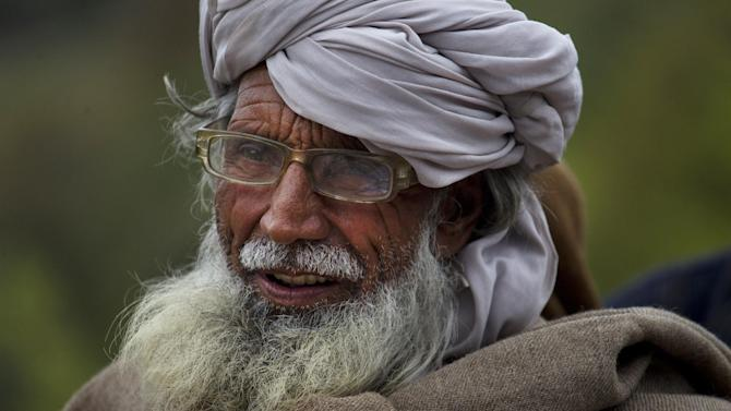 In this Thursday, March 28, 2013 photo, a tribal villager waits for famine relief at a camp run by Pakistan army in Sararogha, which was the stronghold of the Taliban in South Waziristan, the Pakistani tribal area bordering Afghanistan. After battling Taliban militants in the tribal areas bordering Afghanistan for over a decade, the Pakistani military is engaged in a new fight. This time it's for the hearts and minds of the people who are returning to the region after living for years as refugees in their own country and harbor a longstanding mistrust of the central government.(AP Photo/B.K. Bangash)