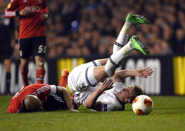 Tottenham Hotspur's Kane is challenged by Benfica's Luisao during their Europa League soccer match at White Hart Lane in London