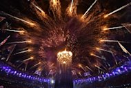 Fireworks burst in the sky above the cauldron bearing the Paralympic Flame at the opening ceremony of the London 2012 Paralympic Games at the Olympic Stadium in east London on August 29, 2012. The stadium will stage an international athletics meeting in July to mark the first anniversary of the 2012 Games opening ceremony