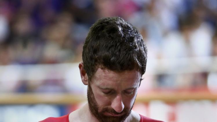 England's Bradley Wiggins stands on the podium before receiving his silver medal in men's 4000m team pursuit finals at the 2014 Commonwealth Games in Glasgow