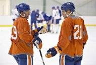 Edmonton Oilers Brad Hunt, left, and Andrew Ference discuss drills during the Edmonton Oilers NHL hockey training camp in Sherwood Park, Alta., on Thursday September 12, 2013. The Oilers named Ference their new team captain on Sunday, making him the 14th in franchise history.THE CANADIAN PRESS/Jason Franson.