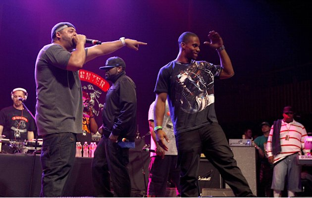 Joell Ortiz of Slaughter House, left, introduces New York Giants wide receiver Victor Cruz, right, during the 'Fuse Live: Shady 2.0' SXSW concert at the Austin Music Hall on Friday, March 16, 2012 in