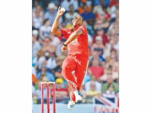 England's Chris Jordan bowls during the T20 International cricket match against West Indies at the Kensington Oval in Bridgetown Thursday. — AP
