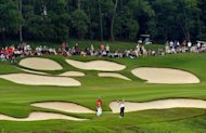 Dustin Johnson of the US plays from the fairway at the 15th hole during the third round of the WGC-HSBC Champions tournament held on the Olazabal Course at the Mission Hill Golf Club in Dongguan, on November 3. The tournament will return to make its &#39;permanent home&#39; in Shanghai next year with an increased, Major-size purse of $8.5 million, officials announced on Sunday