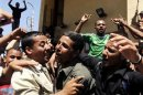 The relatives of seven kidnapped security officers and soldiers celebrate after their return, in the Rafah border