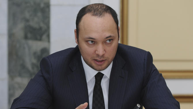 FILE - In this file photo dated Nov. 6, 2009, Maksim Bakiyev, son of deposed Kyrgyz president Kurmanbek Bakiyev, is in the Kyrgyz capital Bishkek. The fugitive son of Kyrgyzstan's deposed president has been arrested by police in London on a U.S. extradition warrant on suspicion of fraud, British and Kyrgyz authorities said Saturday Oct. 12, 2012. (AP Photo/Sultan Dosaliyev, File)