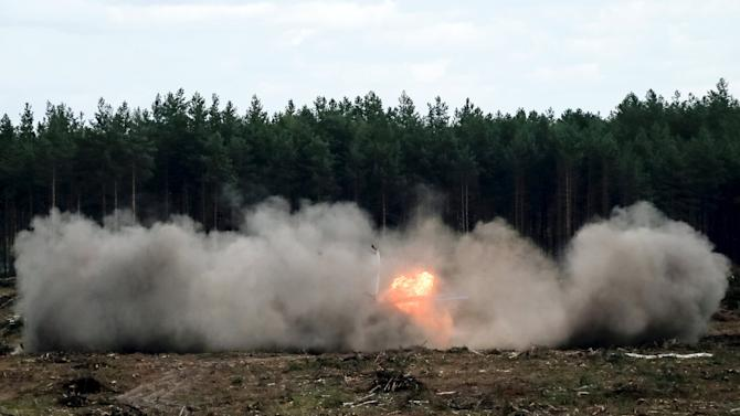 "A Mi-28N helicopter display team is seen on fire after a hard touchdown during the ""Aviadarts"" military aviation competition at the Dubrovichi range near Ryazan"