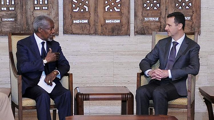 """In this photo provided by the Syrian official news agency SANA, Syrian President Bashar Assad, right, meets with Kofi Annan, the U.N.-Arab League Joint Special Envoy for Syria, in Damascus, Syria. The meeting Tuesday followed a massacre in Houla, Syria, last week in which more than 100 people were killed, some of them women, children and entire families gunned down in their own homes. Following the meeting, Annan told reporters """"We are at a tipping point."""" (AP Photo/SANA)"""