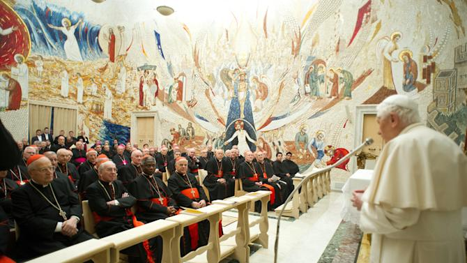 "In this photo provided by the Vatican newspaper L'Osservatore Romano, Pope Benedict XVI, right, delivers his message concluding a weeklong spiritual retreat, at the Vatican, Saturday, Feb. 23, 2013. Benedict XVI has lamented the ""evil, suffering and corruption"" that has defaced God's creation in a final address to the officials who run the Vatican bureaucracy. Benedict spoke off-the-cuff Saturday at the end of a weeklong spiritual retreat coinciding with the Catholic Church's solemn Lenten season. For the past week, Italian Cardinal Gianfranco Ravasi has led the Vatican on meditations that have covered everything from the family to denouncing the ""divisions, dissent, careerism, jealousies"" that afflict the Vatican bureaucracy. (AP Photo/L'Osservatore Romano, ho)"