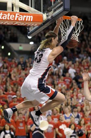 Gonzaga's Kelly Olynyk dunks against Portland in the first half of an NCAA college basketball game on Saturday, March 2, 2013, in Spokane, Wash. (AP Photo/Jed Conklin)