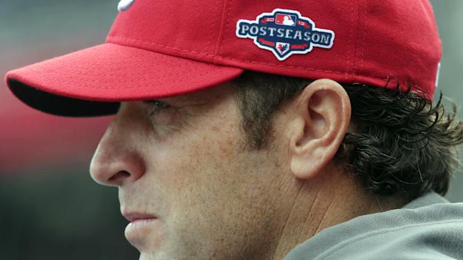 St. Louis Cardinals manager Mike Matheny looks on as his players take batting practice before Game 3 of the National League division baseball series against the Washington Nationals on Wednesday, Oct. 10, 2012, in Washington. (AP Photo/Pablo Martinez Monsivais)