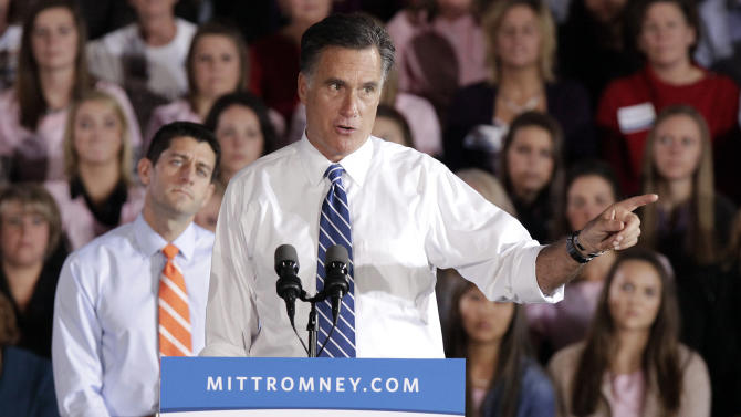 Republican presidential candidate and former Massachusetts Gov. Mitt Romney speaks at a campaign event as his vice presidential running mate Rep. Paul Ryan, R-Wis., listens, Sunday, Oct. 28, 2012, at Koehler Athletic Complex on the campus of the University of Findlay in Findlay, Ohio. (AP Photo/J.D. Pooley)