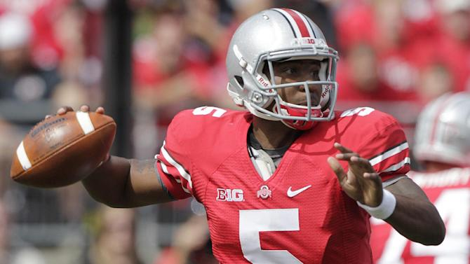 Ohio State's Braxton Miller drops back to pass against California during the first quarter of an NCAA college football game Saturday, Sept. 15, 2012, in Columbus, Ohio. (AP Photo/Jay LaPrete)